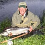 Photo of Willie Banks with a large salmon