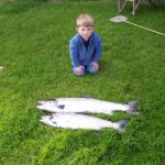 Photo of Hamish with two fish