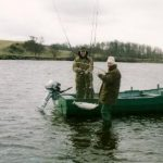 Photo of Dougy netting a fish for a client