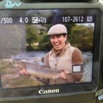 Photo of camera display of Juliette T. holding a salmon